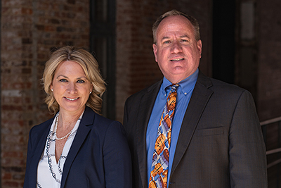 Group photo of Susan Hess and Terry Kurt Hammer Law Attorneys
